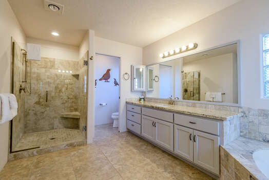 Master Bath with Two Separate, Granite Counter Vanities, a Tile Shower and Water Closet