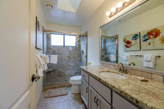Full Shared Bath with a Granite Counter Sink and Tile/Glass Shower