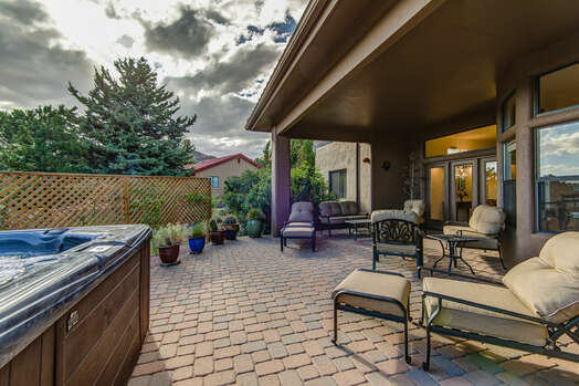 Private Backyard with Comfortable Furnishings and a Hot Tub