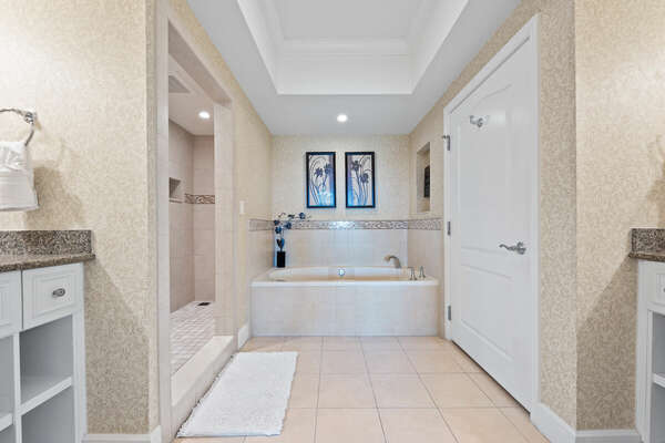 The master ensuite bathroom also has a bathtub and separate walk-in shower.