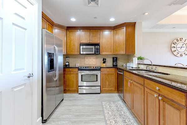 The kitchen is fully equipped with stainless steel appliances, perfect for preparing your favorite home-made dishes