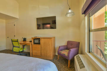 Studio style bedroom and kitchenette with TV