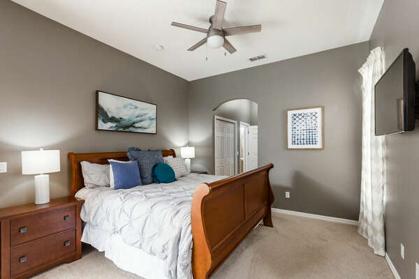 The master bedroom is located on the ground floor and has direct access to the pool