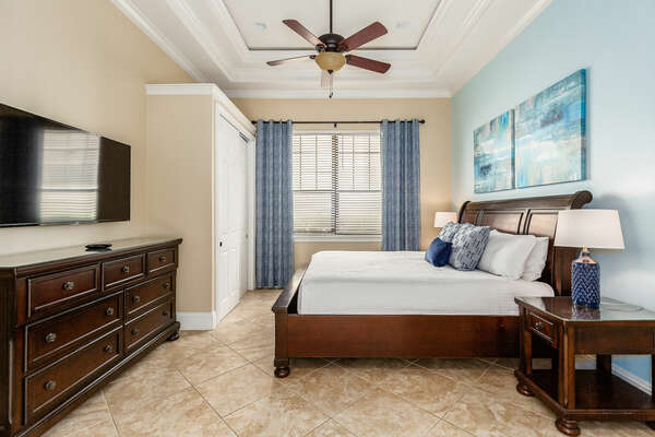 The final master bedroom has a queen-size bed and a large TV