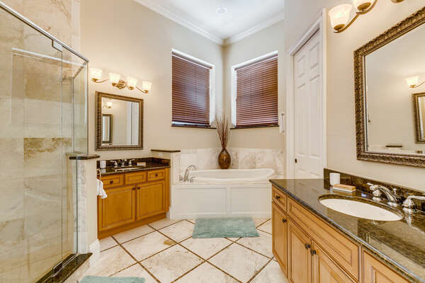 Large ensuite bath with a walk-in shower and garden tub