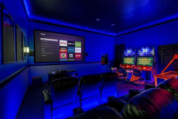 It doubles as a theater room with a projection screen and theater style seating