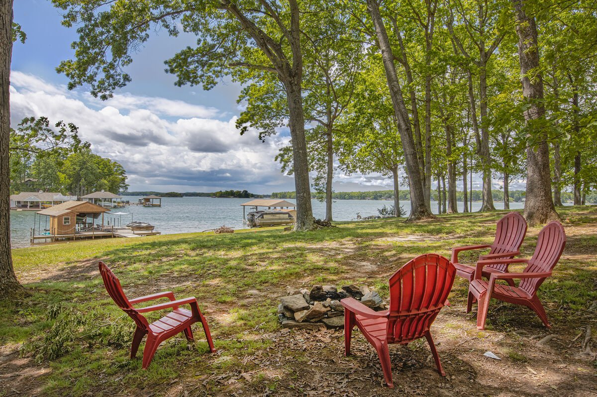 Flat Lot With Beach, fireplace, and seating.