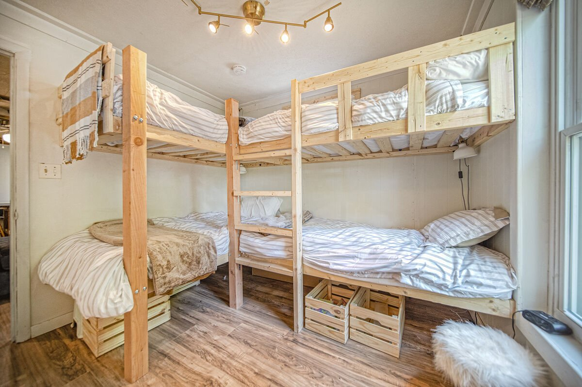 A close picture of the set of bunk beds in the bunk room.