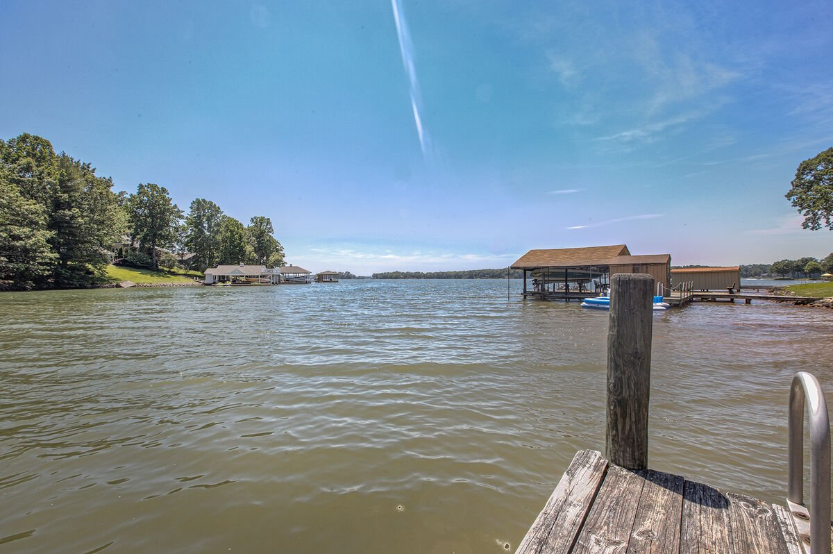 A view of the lake from the dock near this home.