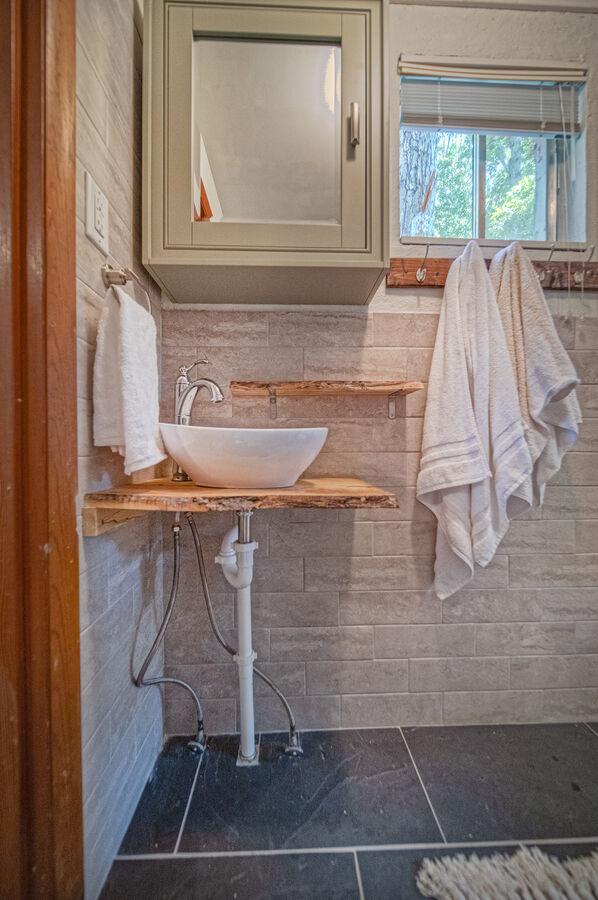 Side bathroom with vanity sink.