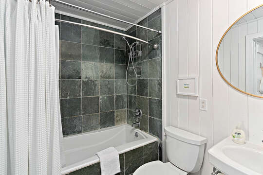 Full Bath with Dark Tile in our Beachfront Rental in St. Simons Island, GA