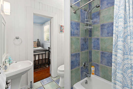 Full Bath with Blue and Green Tile Decor