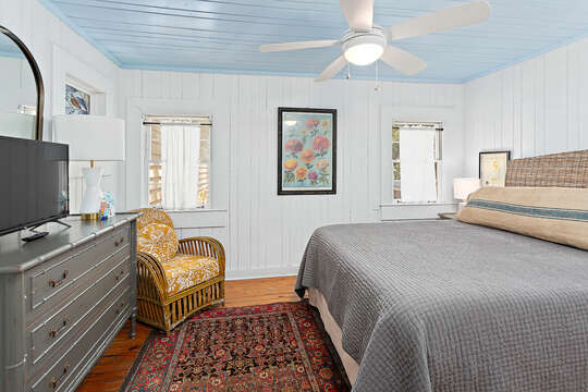 Bedroom with Large Bed and Gray Colored Linens