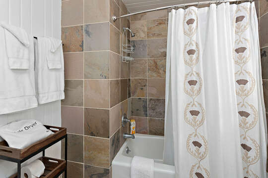 Brown Tiled Bathroom with Tub/Shower Combo