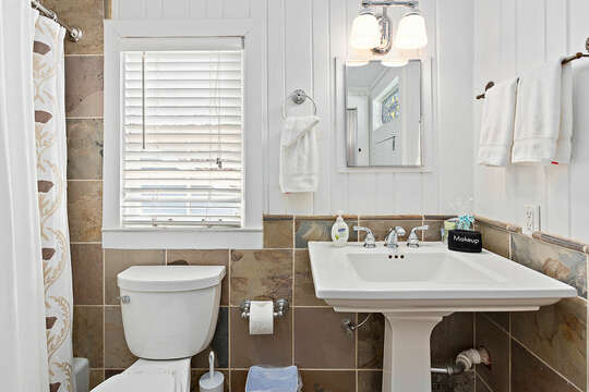 Full Bath with a Pedestal Sink and Window