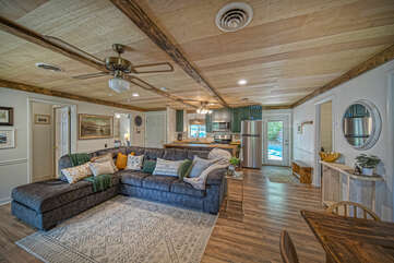 Living area of this waterfront Smith Mountain Lake vacation rental, with sectional couch and dining table.