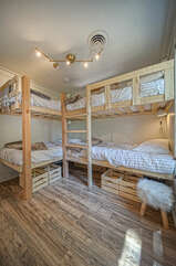 Two sets of bunk beds in the  bunk room.