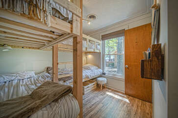 Bunk room with two sets of bunk beds.
