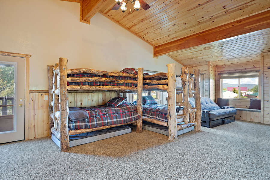 Henrys Hawk ~ loft (considered a bedroom) w/ 2 single over single bunk beds, (trundle mattress underneath each bunk bed HAVE BEEN REMOVED), and futon
