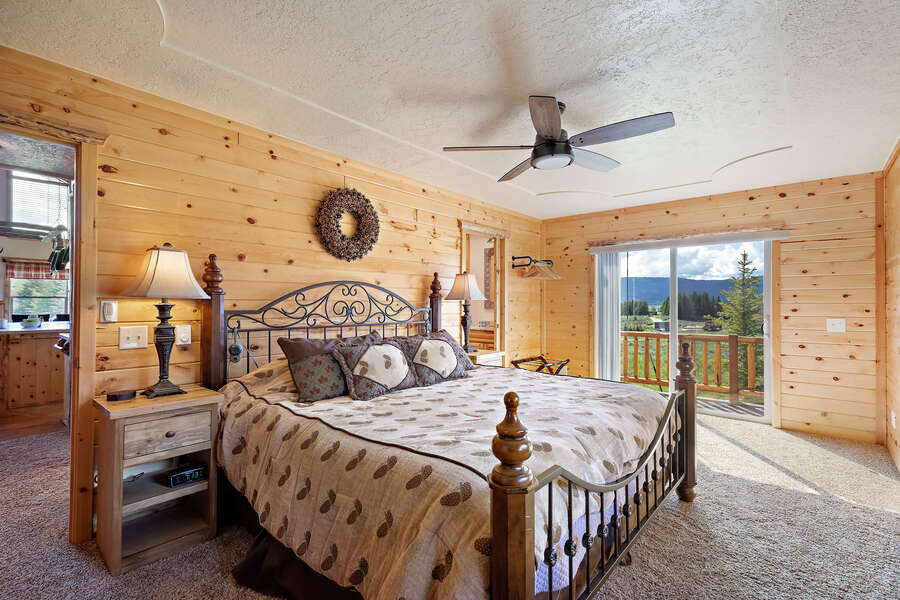 Henrys Hawk ~ main level master bedroom w/ queen bed, private full bathroom, and private entrance to wraparound porch