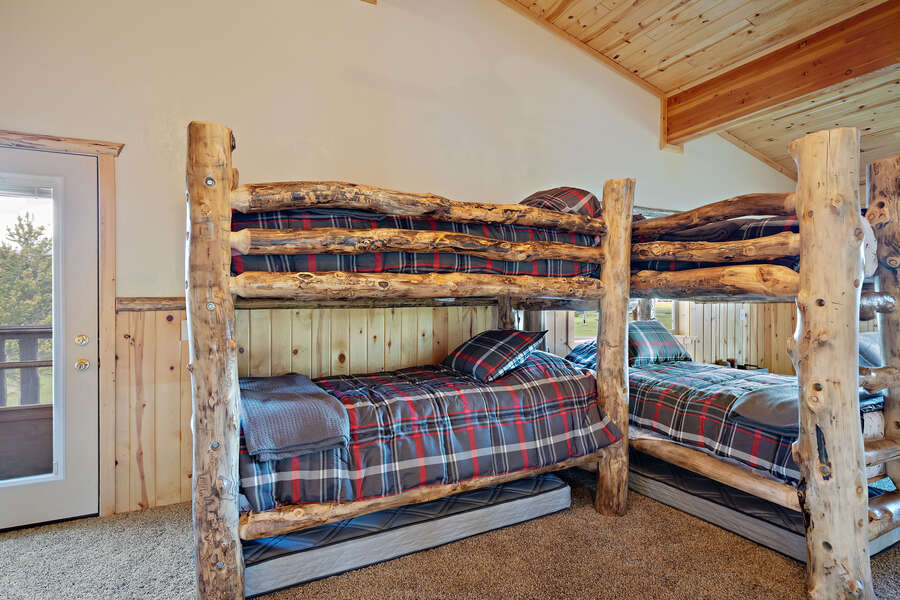 Henrys Hawk ~ loft (considered a bedroom) w/ 2 single over single bunk beds, (trundle mattress underneath each bunk bed HAVE BEEN REMOVED), and exit to back stairs