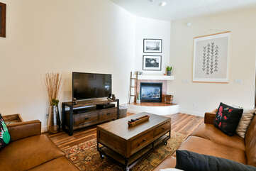 Living room with plenty of seating and TV