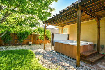 Hot tub and private yard with a view