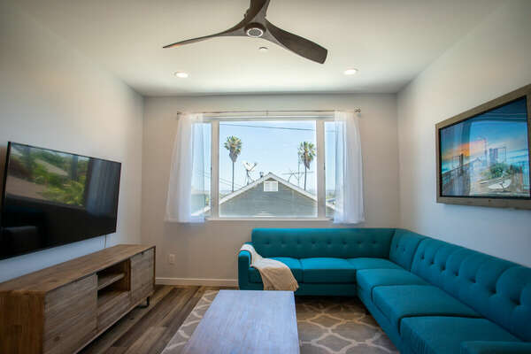Living Room with Sectional and Street View