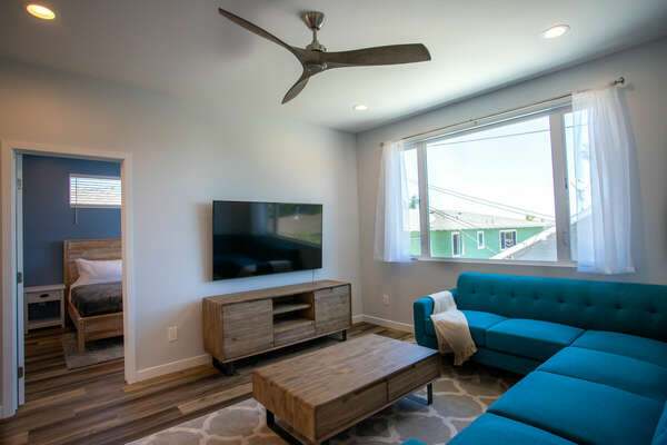 Living Room with Blue Sectional and TV