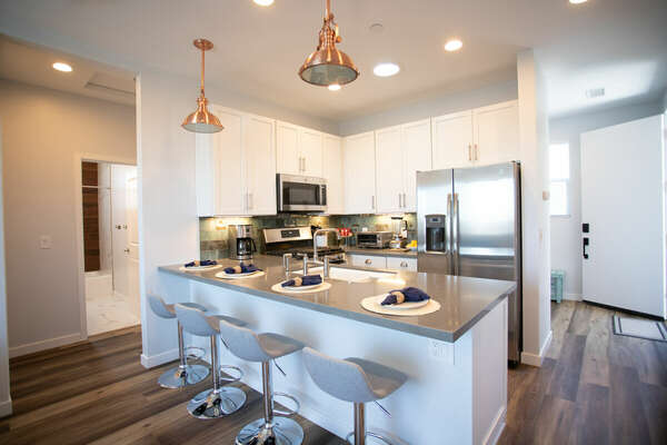 Fully Stocked Kitchen with Breakfast Bar - Second Floor