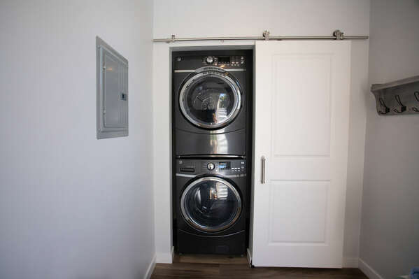 Laundry Room with Stacking Washer/Dryer