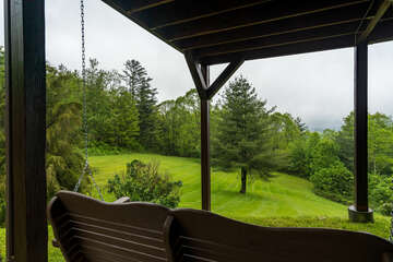 Ground Level Wooden Swing overlooking the Mountains