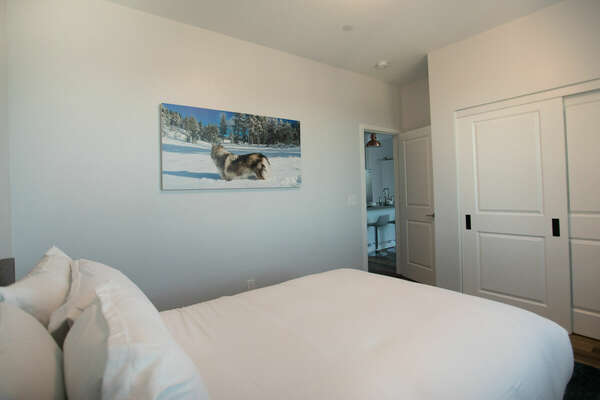 Guest Bedroom with Queen Bed and Closet