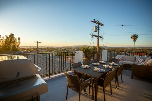 Rooftop Lounging Area with Dining and Seating Area
