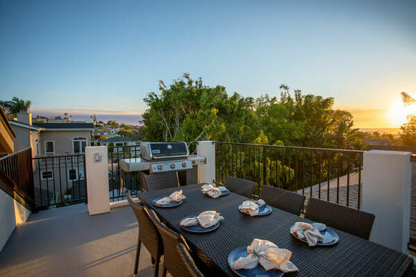 Rooftop Lounging Area with Dining Table and BBQ