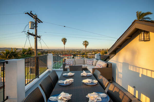 Rooftop Lounging Area with Dining Table