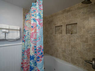 Shower/tub combination in 2nd bathroom off guest room.
