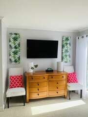 Enjoy the wall mounted flat screen TV in the guest bedroom.
