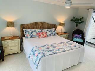Master bedroom has a king size bed with sliding door access to deck.