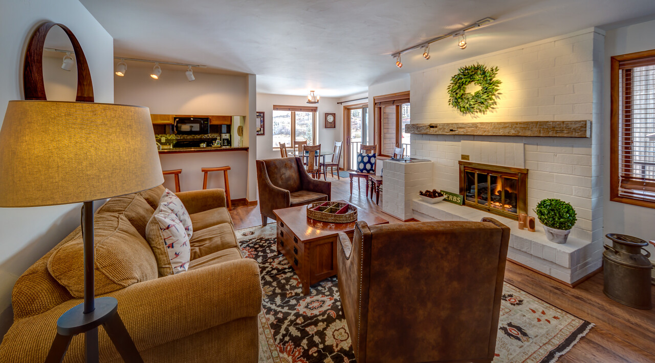 Living Room with a plush furniture set and a fireplace in our Steamboat Colorado rental