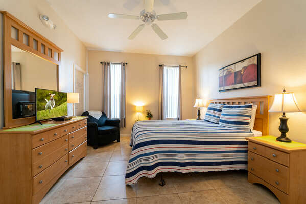 Master suite downstairs with a queen bed and TV