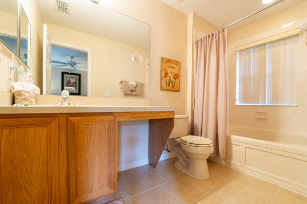 Master bath upstairs with a garden tub/shower combo with a single sink vanity