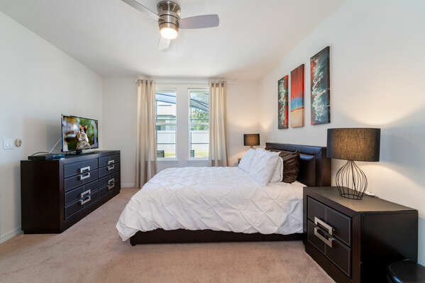 Master suite with Queen bed and view of pool