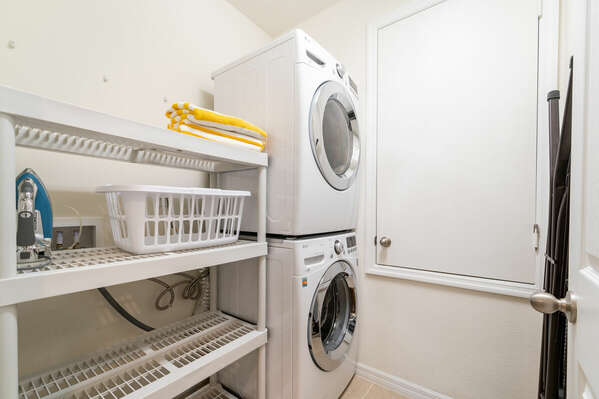 Full size laundry facilities with shelving