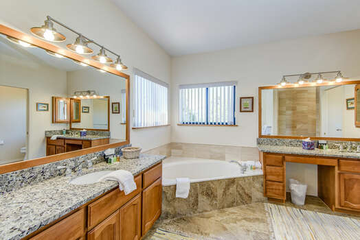 Master Bath with Two Separate Vanities, a Large Soaking Tub and Tile Shower