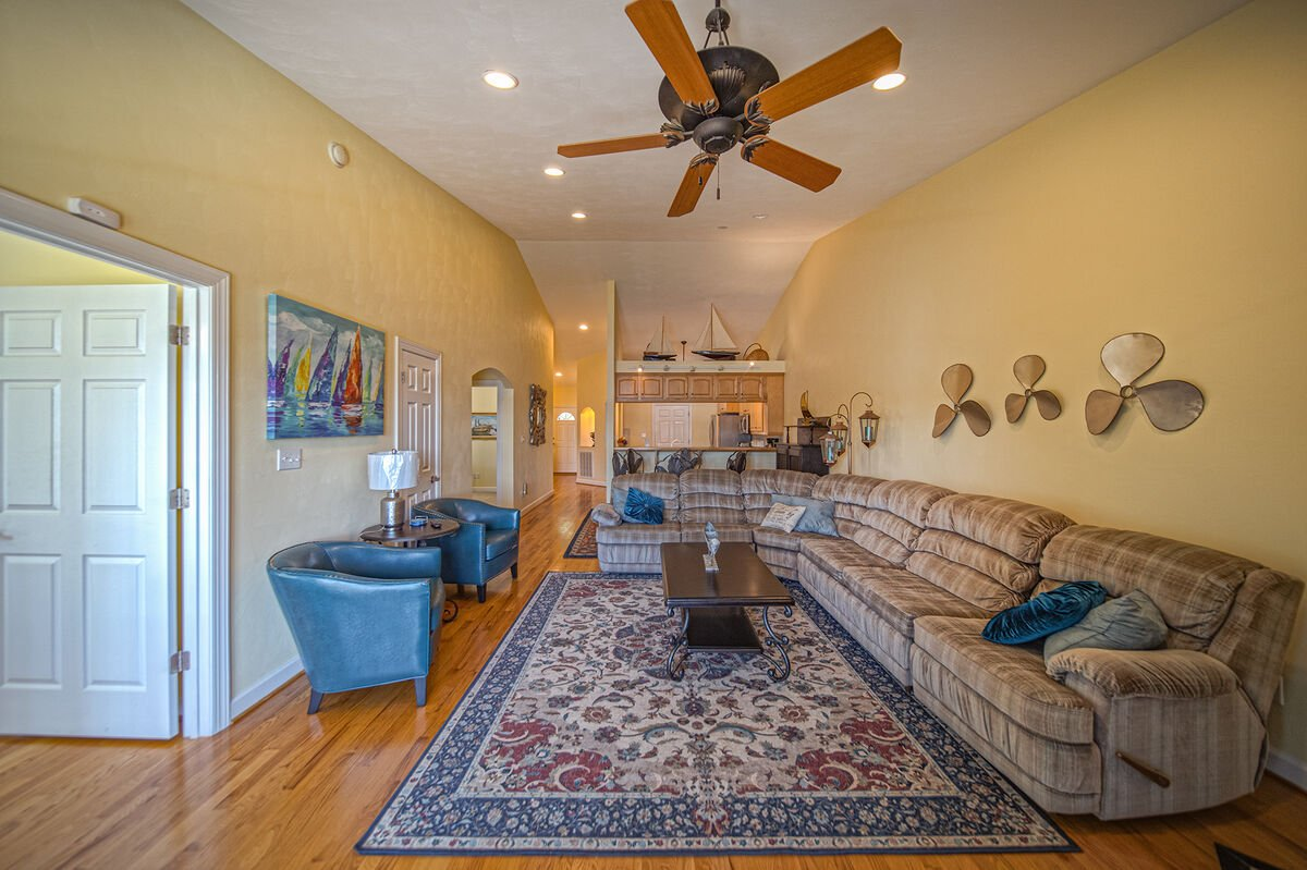 Large Living Area on the Maine Floor with sectional couch and two armchairs.