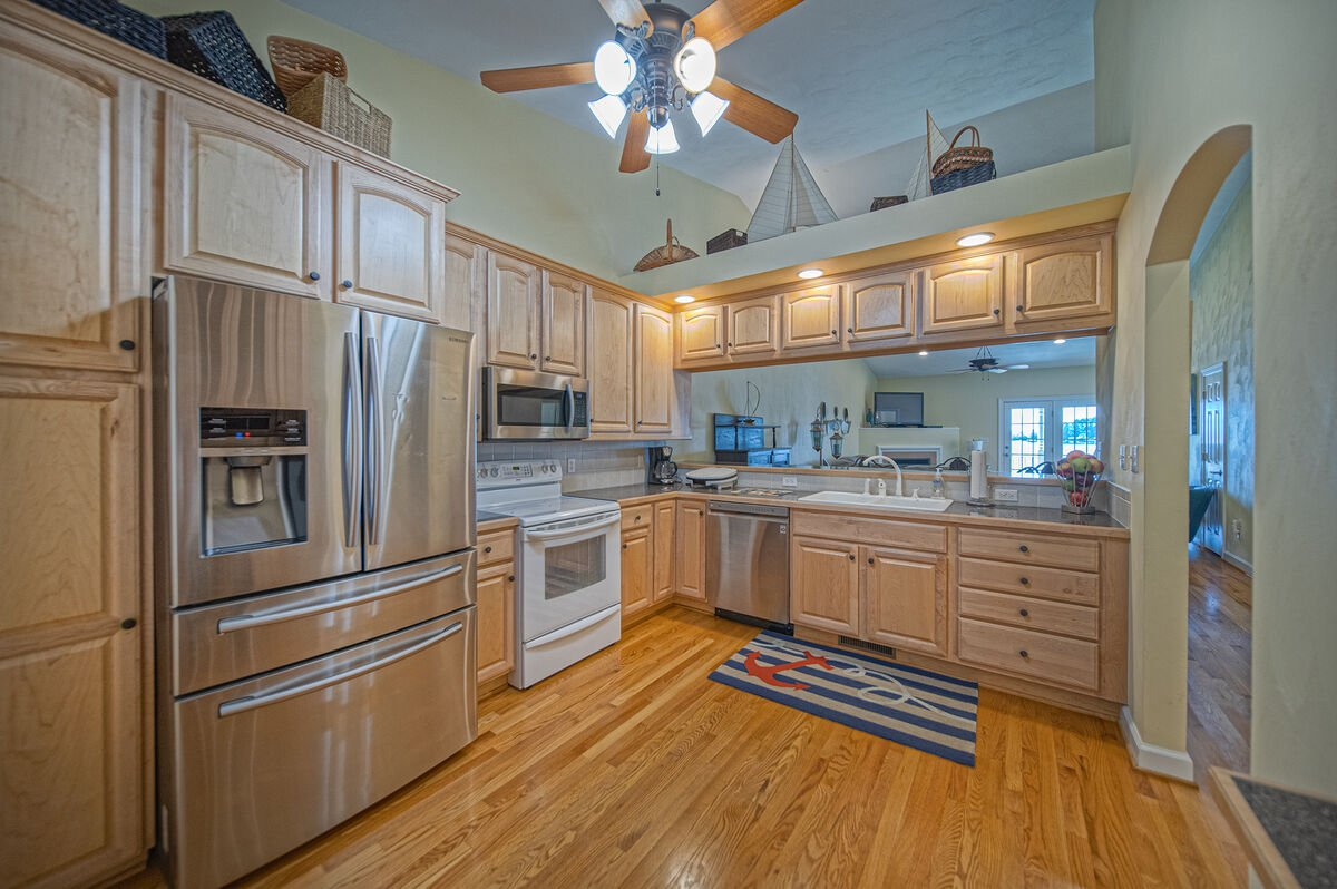 Angled photo of the kitchen and its stainless steel appliances.