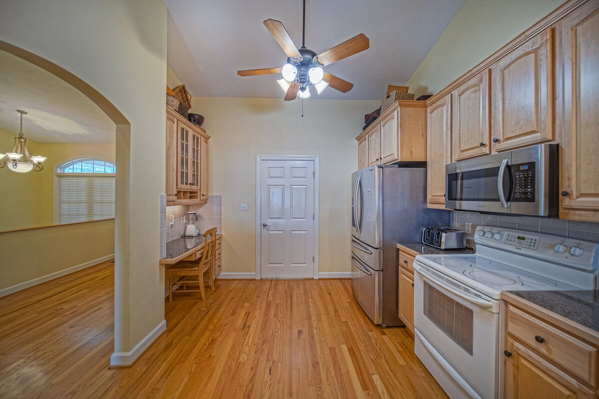 Kitchen with modern appliances and ample floor space.