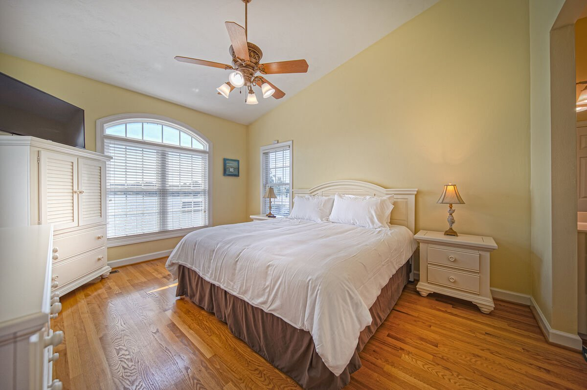 Master Bedroom Overlooking Lake on the Main Level, with large bed and twin nightstands.