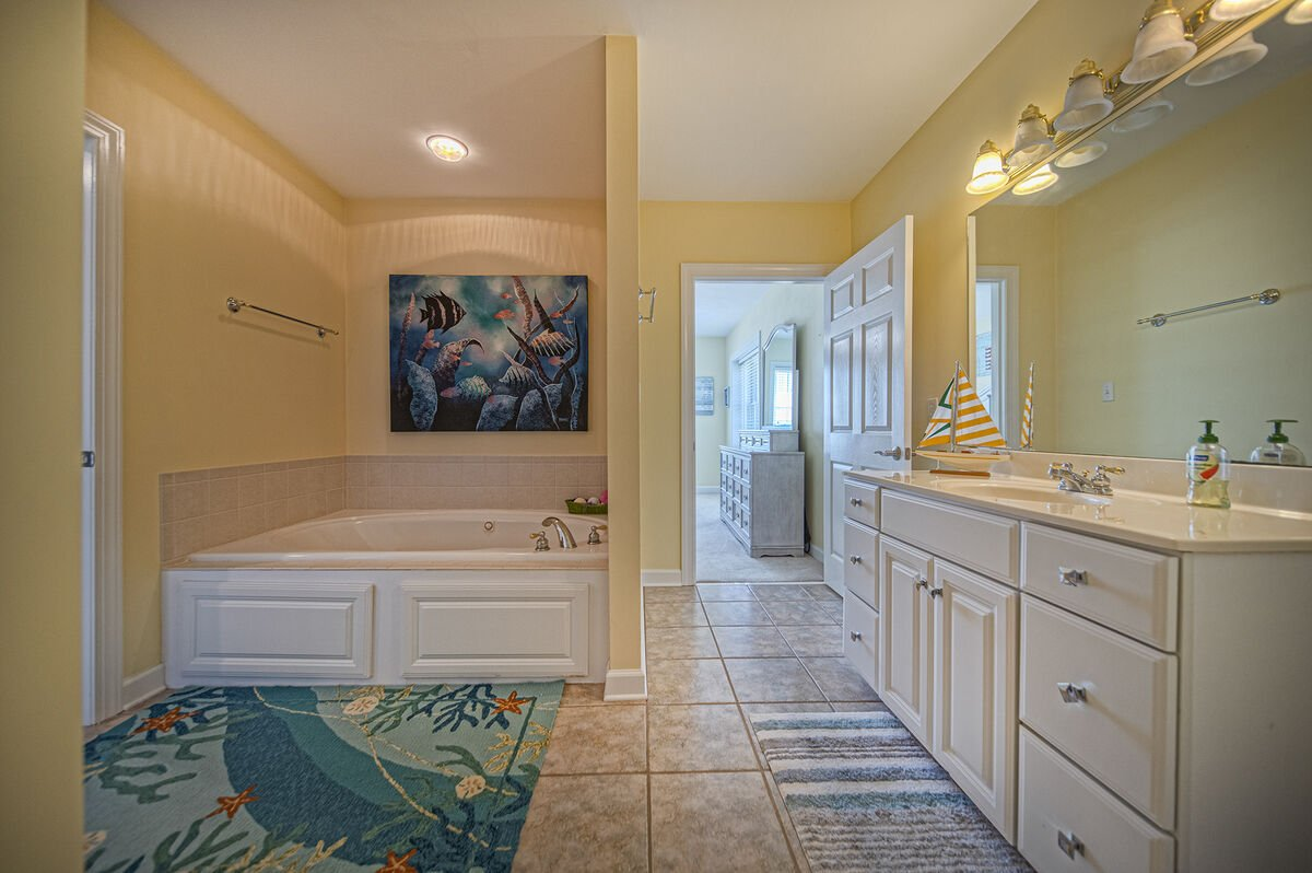 Lower Level master Bath with Tub and vanity sink.